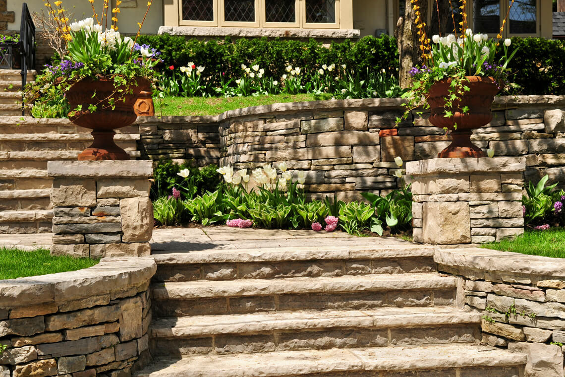 stone stairs with flowers on the side