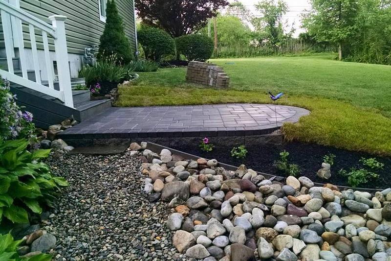 backyard small patio with rock walkway