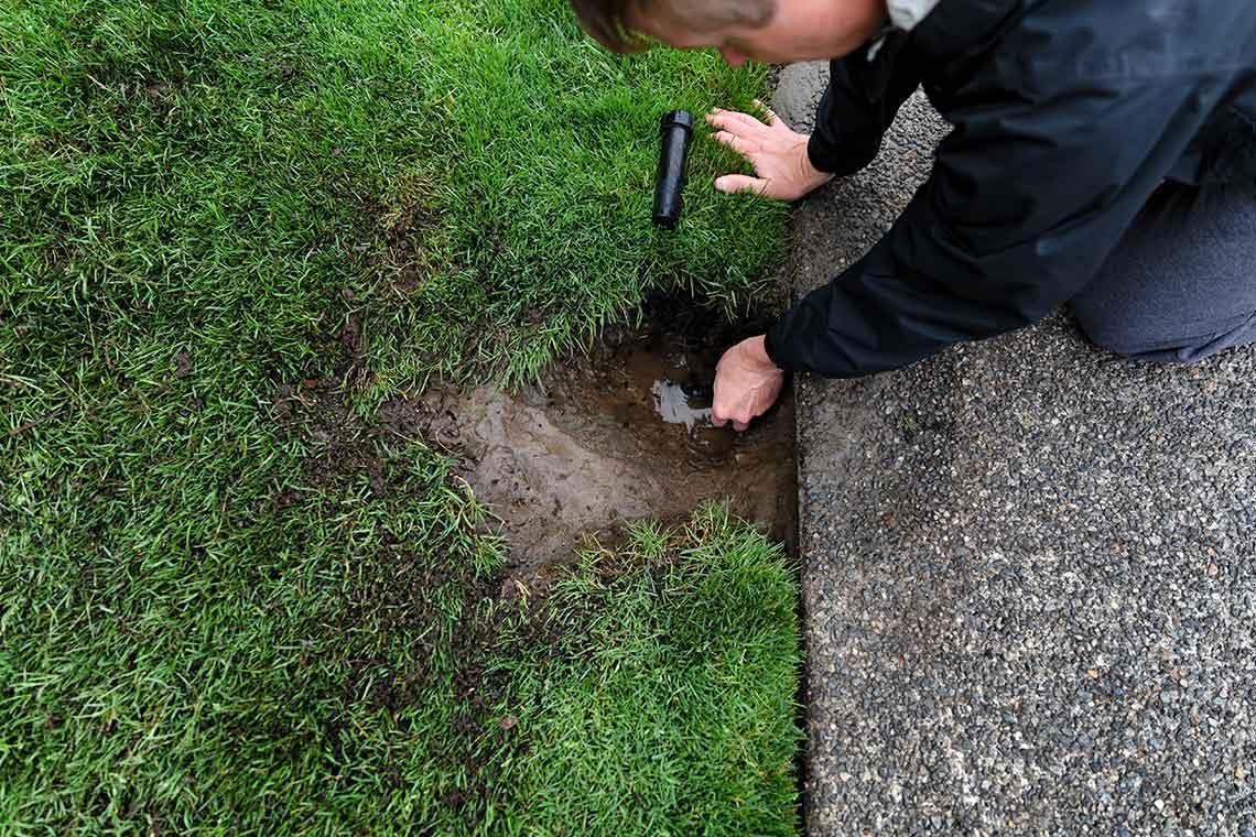man installing a sprinkler head
